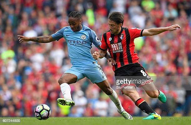 Raheem Sterling of Manchester City and Harry Arter of AFC Bournemouth battle for possession during the Premier League match between Manchester City...