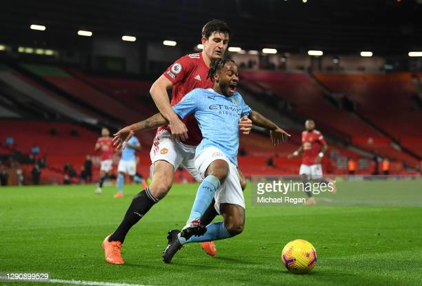 Raheem Sterling of Manchester City and Harry Maguire of Manchester United battle for the ball during the Premier League match between Manchester...