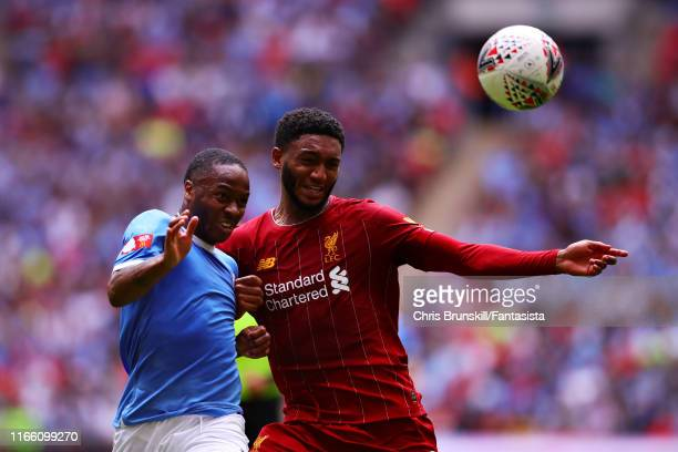 Raheem Sterling of Manchester City and Joe Gomez of Liverpool battle for the ball during the FA Community Shield match between Liverpool and...