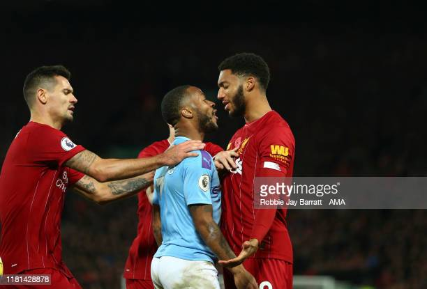 Raheem Sterling of Manchester City and Joe Gomez of Liverpool during the Premier League match between Liverpool FC and Manchester City at Anfield on...