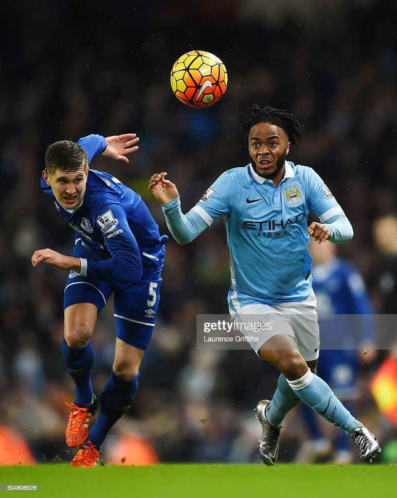 Raheem Sterling of Manchester City and John Stones of Everton compete for the ball during the Barclays Premier League match between Manchester City and Everton at the Etihad Stadium on January 13, 2016 in Manchester, England.