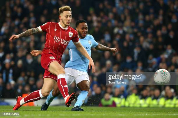 Raheem Sterling of Manchester City and Josh Brownhill of Bristol City during the Carabao Cup SemiFinal First Leg match between Manchester City and...