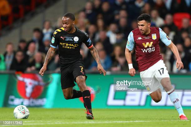 Raheem Sterling of Manchester City and Mahmoud Hassan of Aston Villa in action during the Carabao Cup Final match between Aston Villa and Manchester...