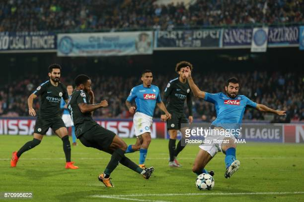Raheem Sterling of Manchester City and Raul Albiol of Napoli during the UEFA Champions League group F match between SSC Napoli and Manchester City at...