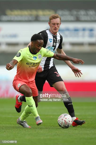 Raheem Sterling of Manchester City and Sean Longstaff of Newcastle United during the FA Cup Quarter Final match between Newcastle United and...