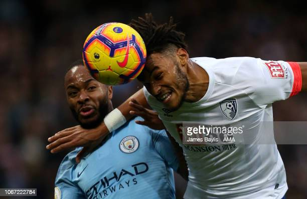 Raheem Sterling of Manchester City and Tyrone Mings of Bournemouth during the Premier League match between Manchester City and AFC Bournemouth at...