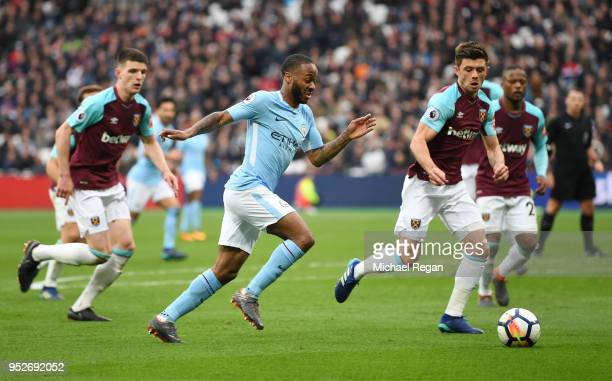 Raheem Sterling of Manchester City attempts to get past Aaron Cresswell of West Ham United during the Premier League match between West Ham United...