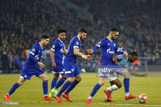 Raheem Sterling of Manchester City battle for possession with Nabil Bentaleb of FC Schalke 04 during the UEFA Champions League Round of 16 First Leg...