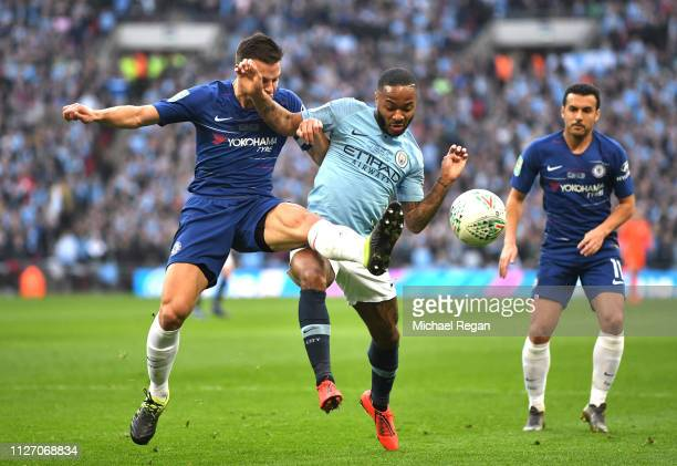 Raheem Sterling of Manchester City battles for possession with Cesar Azpilicueta of Chelsea during the Carabao Cup Final between Chelsea and...