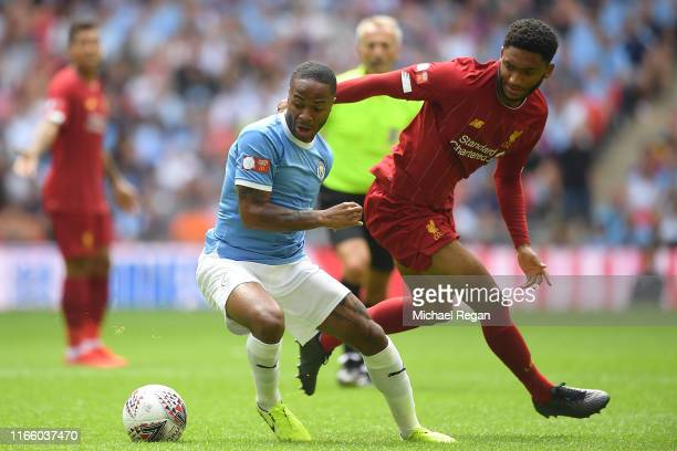 Raheem Sterling of Manchester City battles for possession with Joe Gomez of Liverpool during the FA Community Shield match between Liverpool and...
