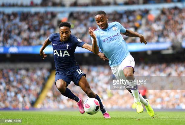 Raheem Sterling of Manchester City battles for possession with Kyle WalkerPeters of Tottenham Hotspur during the Premier League match between...