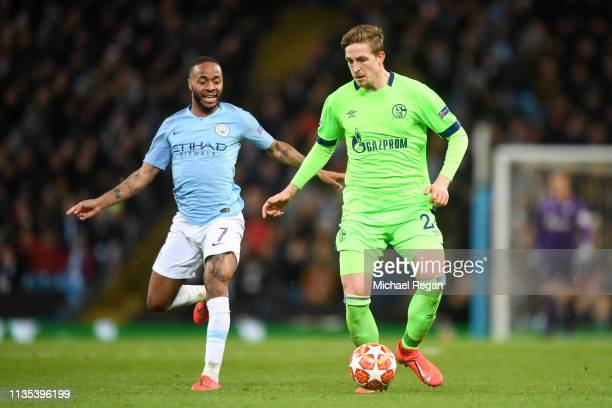 Raheem Sterling of Manchester City battles for possession with Bastian Oczipka of FC Shalke 04 during the UEFA Champions League Round of 16 Second...