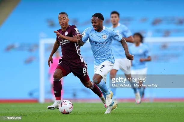 Raheem Sterling of Manchester City battles for possession with Youri Tielemans of Leicester City during the Premier League match between Manchester...