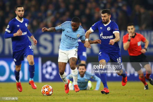 Raheem Sterling of manchester City battles for the ball with Daniel Caligiuri and Nabil Bentaleb of Schalke 04 during the UEFA Champions League Round...