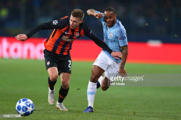 Raheem Sterling of Manchester City battles for the ball with Mykola Matviyenko of Shakhtar Donetsk during the Group F match of the UEFA Champions...