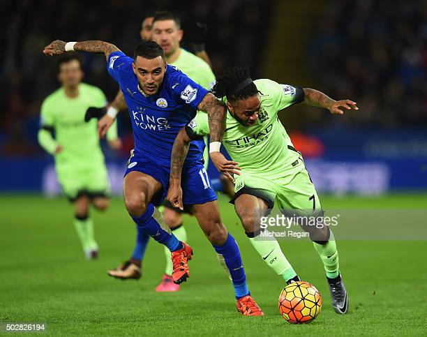 Raheem Sterling of Manchester City battles with Danny Simpson of Leicester City during the Barclays Premier League match between Leicester City and...