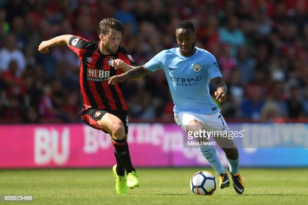 Raheem Sterling of Manchester City battles with Harry Arter of Bournemouth during the Premier League match between AFC Bournemouth and Manchester...