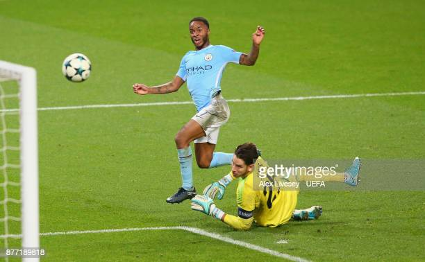 Raheem Sterling of Manchester City beats Brad Jones of Feyenoord to score the opening goal during the UEFA Champions League group F match between...