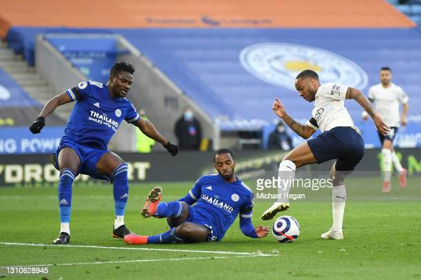 Raheem Sterling of Manchester City beats Daniel Amartey and Ricardo Pereira of Leicester City in the build up to Manchester City's second goal scored...