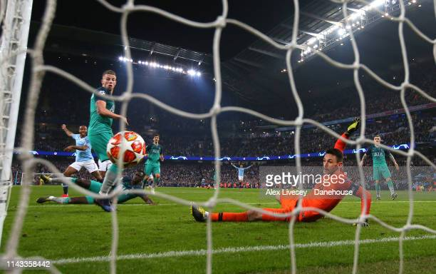 Raheem Sterling of Manchester City beats Hugo Lloris of Tottenham Hotspur to score a goal only for it to be disallowed by VAR during the UEFA...