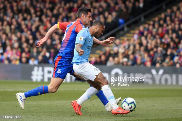 Raheem Sterling of Manchester City beats Scott Dann of Crystal Palace as he scores his team's first goal during the Premier League match between...