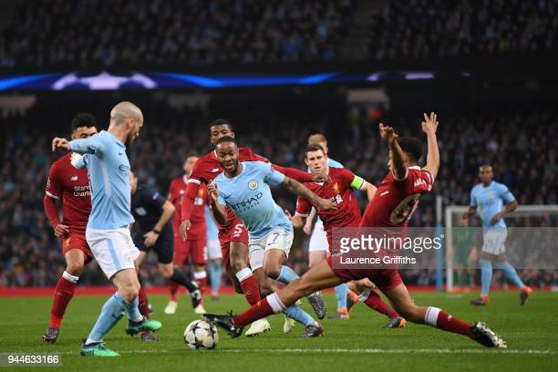 Raheem Sterling of Manchester City breaks past Trent AlexanderArnold of Liverpool during the Quarter Final Second Leg match between Manchester City...