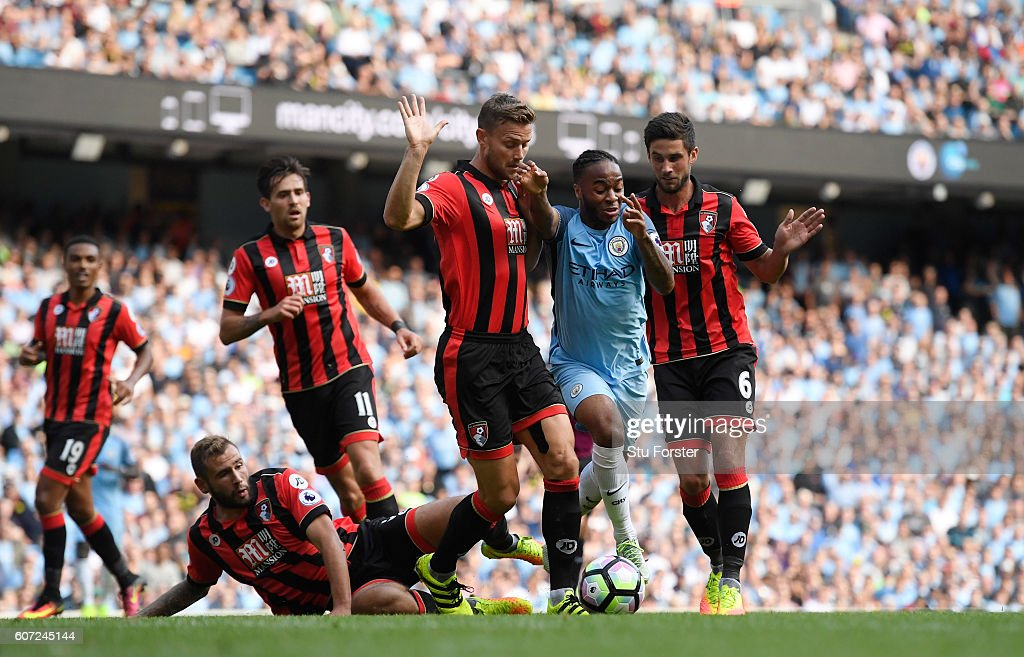 Raheem Sterling of Manchester City burst through the AFC Bournemouth defence during the Premier League match between Manchester City and AFC Bournemouth at the Etihad Stadium on September 17, 2016 in Manchester, England.