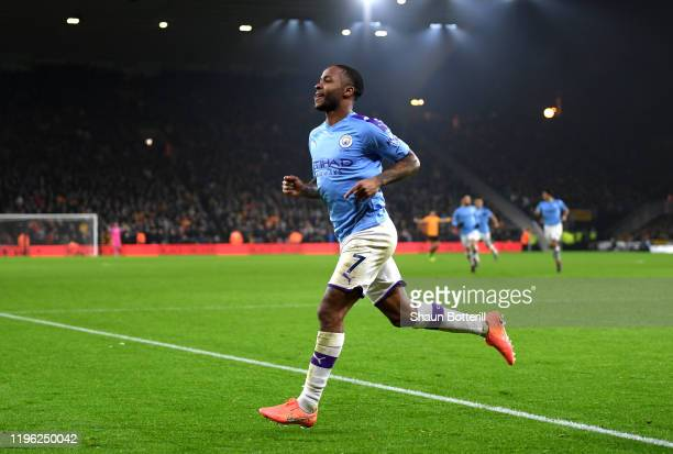 Raheem Sterling of Manchester CIty celebrates after he scores his sides second goal during the Premier League match between Wolverhampton Wanderers...