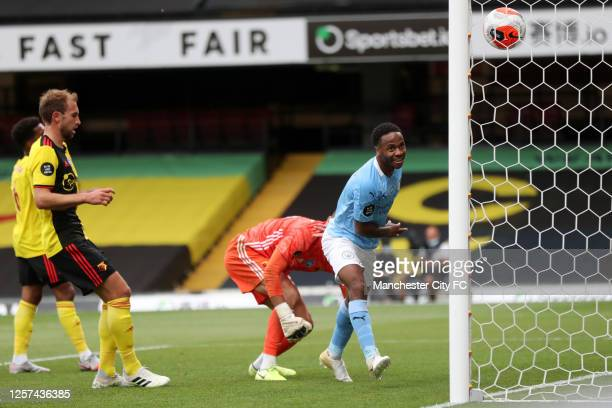 Raheem Sterling of Manchester City celebrates after he scores his sides second goal from the penalty spot during the Premier League match between...