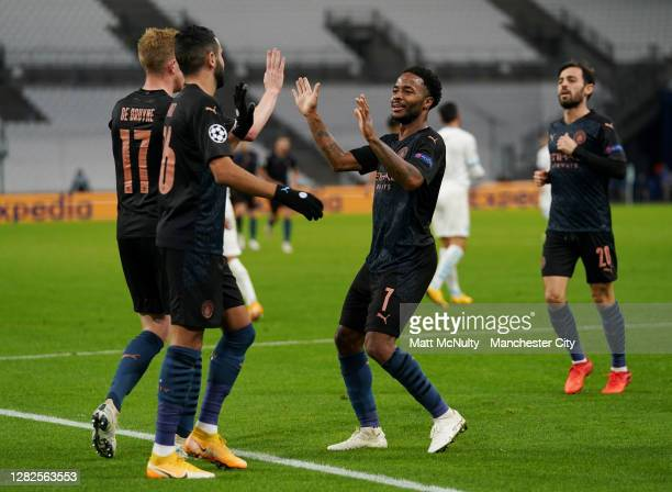 Raheem Sterling of Manchester City celebrates after he scores his team's third goal during the UEFA Champions League Group C stage match between...