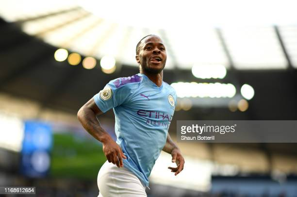 Raheem Sterling of Manchester City celebrates after scoring his sides first goal during the Premier League match between Manchester City and...