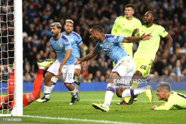 Raheem Sterling of Manchester CIty celebrates after scoring his sides first goal during the UEFA Champions League group C match between Manchester...