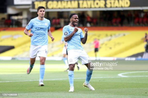 Raheem Sterling of Manchester City celebrates after scoring his sides first goal during the Premier League match between Watford FC and Manchester...