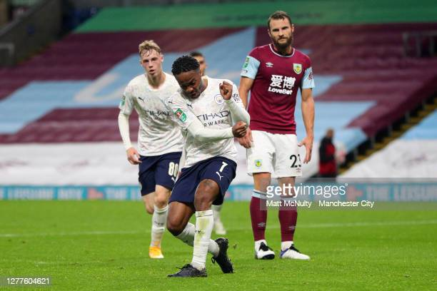 Raheem Sterling of Manchester City celebrates after scoring his sides first goal during the Carabao Cup fourth round match between Burnley and...