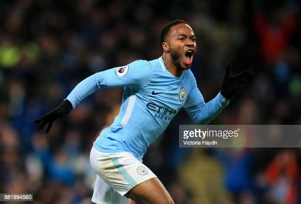 Raheem Sterling of Manchester City celebrates after scoring his sides second goal during the Premier League match between Manchester City and...