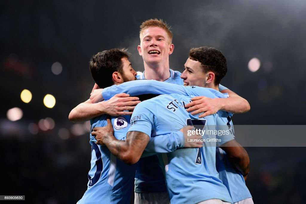 Raheem Sterling of Manchester City celebrates after scoring his sides fourth goal with Kevin De Bruyne of Manchester City, Phil Foden of Manchester City, Bernardo Silva of Manchester City during the Premier League match between Manchester City and Tottenham Hotspur at Etihad Stadium on December 16, 2017 in Manchester, England.