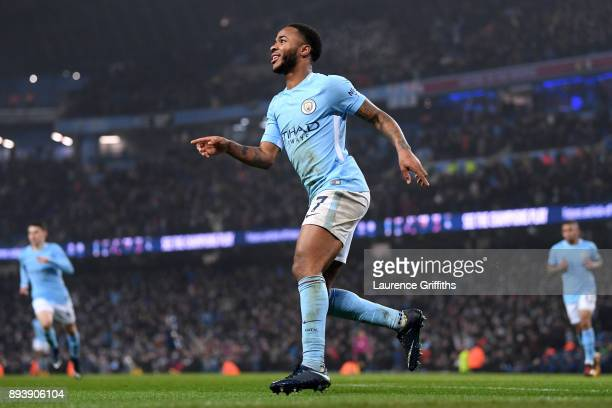 Raheem Sterling of Manchester City celebrates after scoring his sides fourth goal during the Premier League match between Manchester City and...