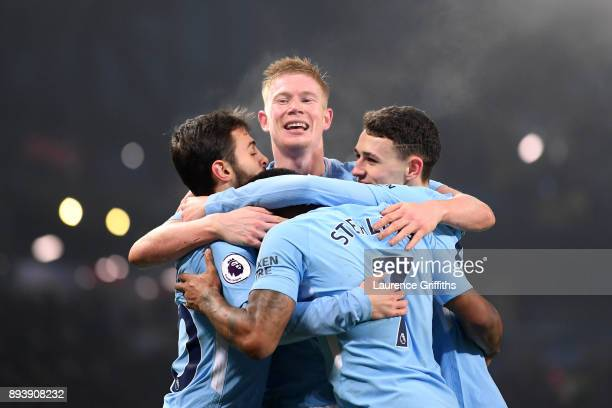 Raheem Sterling of Manchester City celebrates after scoring his sides fourth goal with his Manchester City team mates during the Premier League match...