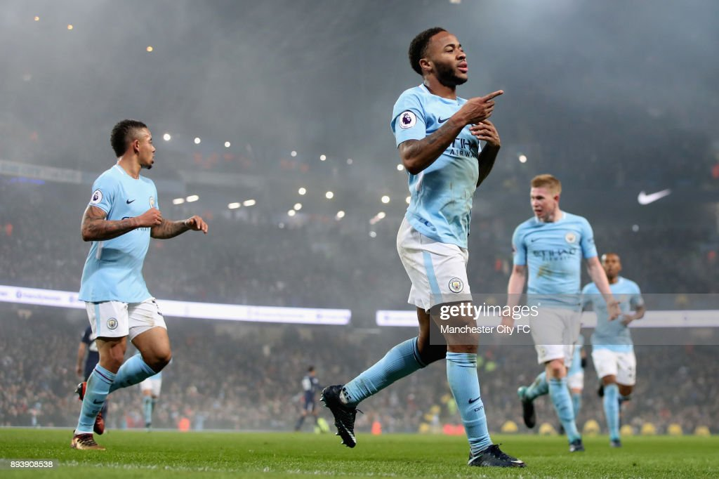 Raheem Sterling of Manchester City celebrates after scoring his sides fourth goal during the Premier League match between Manchester City and Tottenham Hotspur at Etihad Stadium on December 16, 2017 in Manchester, England.