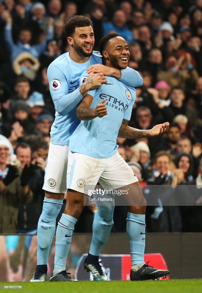 Raheem Sterling of Manchester City celebrates after scoring his sides second goal with Kyle Walker of Manchester City during the Premier League match between Manchester City and AFC Bournemouth at Etihad Stadium on December 23, 2017 in Manchester, England.