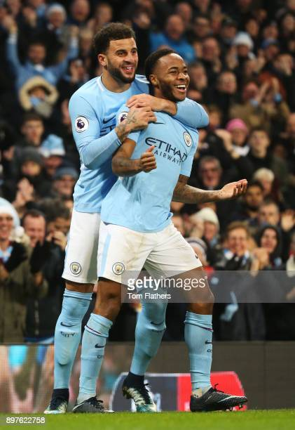 Raheem Sterling of Manchester City celebrates after scoring his sides second goal with Kyle Walker of Manchester City during the Premier League match...