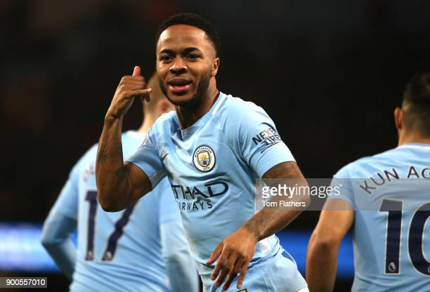 Raheem Sterling of Manchester City celebrates after scoring his sides first goal during the Premier League match between Manchester City and Watford...