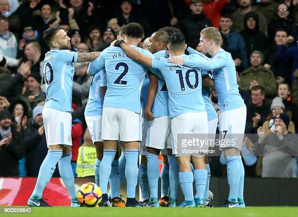 Raheem Sterling of Manchester City celebrates after scoring his sides first goal with his Manchester City team mates during the Premier League match...