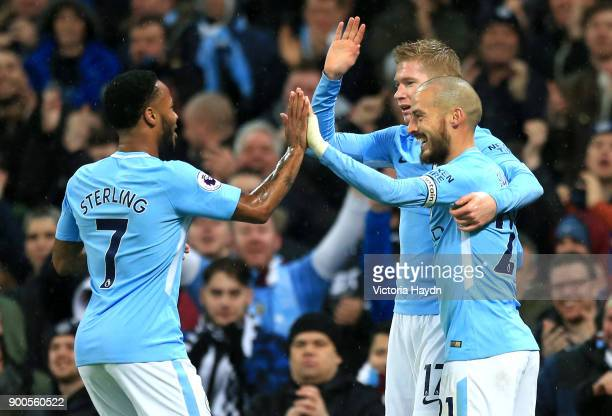 Raheem Sterling of Manchester City celebrates after scoring his sides first goal with David Silva of Manchester City and Kevin De Bruyne of...