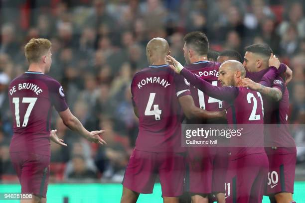 Raheem Sterling of Manchester City celebrates after scoring his sides third goal with his team mates during the Premier League match between...