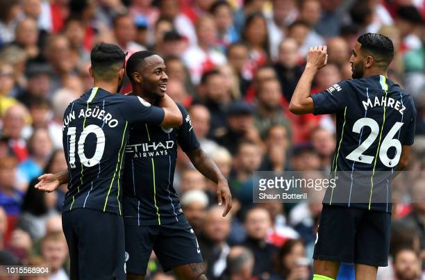 Raheem Sterling of Manchester City celebrates after scoring his team's first goal with Sergio Aguero and Riyad Mahrez during the Premier League match...