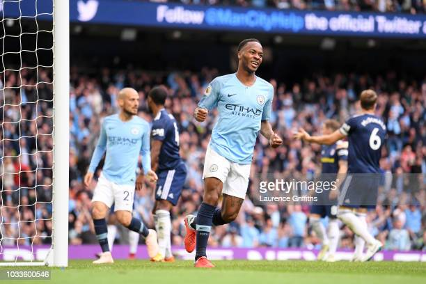 Raheem Sterling of Manchester City celebrates after scoring his team's third goal during the Premier League match between Manchester City and Fulham...