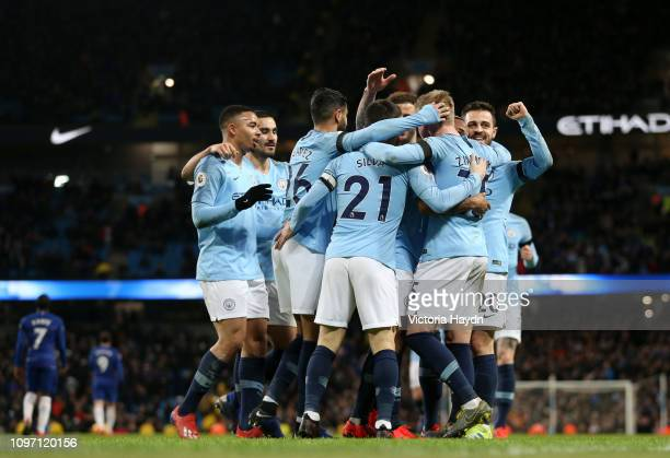 Raheem Sterling of Manchester City celebrates after scoring his team's seventh goal with his team mates during the Premier League match between...