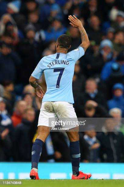 Raheem Sterling of Manchester City celebrates after scoring his team's second goal during the Premier League match between Manchester City and...