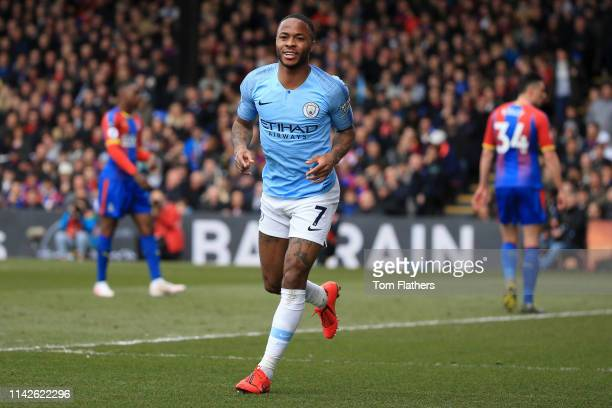Raheem Sterling of Manchester City celebrates after scoring his team's first goal with team mates during the Premier League match between Crystal...
